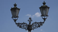 Beautiful public lamp street lamppost blue sky medieval decoration artwork city  Stock Footage