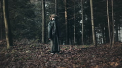 Teddy bear in a forest. Child disguised as teddy bear in a leather coat. Stock Footage