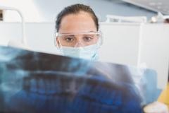 Stock Photo of Dentist wearing surgical mask and safety glasses