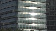 Sunlight reflection residential modern house glass facade window tower high rise Stock Footage