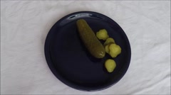 Marinated cucumbers on the plate Stock Footage