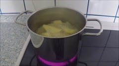 Cooking Potatoes In Boiling Water cooking pot Stock Footage