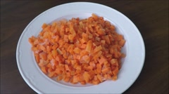 Sliced carrots in a white plate Stock Footage
