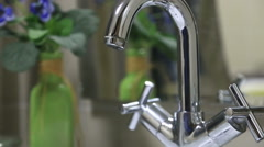 Water pouring out of  bathroom faucet Stock Footage