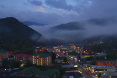 Clouds cover Mtns over Gatlinburg, TN at dusk Stock Footage