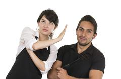 Young attractive couple chefs wearing black apron Stock Photos