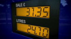 Zoom in on UK petrol pump starting at 30 pounds - stock footage