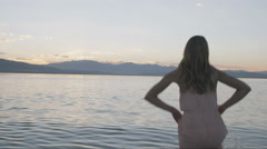 Young woman dives into lake Stock Footage