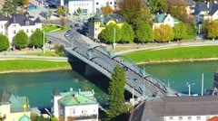 Timelapse of traffic in Salzburg crossing River Salzach Stock Footage