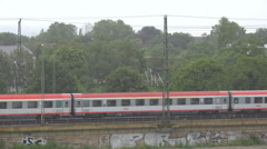 German passenger train pass rainy day storm rain day people commute travel trip  Stock Footage