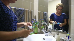 Woman Brushing Her Teeth 5 Stock Footage