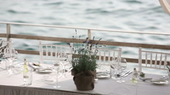 Served table in a restaurant on the beach in Europe at sunset Stock Footage