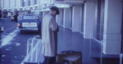 Man Ariport Suitcase Carrier 60s 70s 16mm 4K Stock Footage