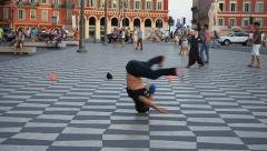 Break dancer does headspin in city square slowmotion clip 1 Stock Footage