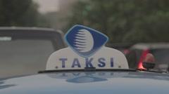 Traffic Jakarta Taxi (Taksi) - Close Up Stock Footage