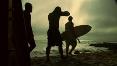 3 Surfers Walk Down Stairs Silhouette Slow Motion Stock Footage