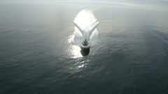 Aerial view of a maxi rib navigating  - stock footage