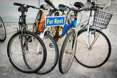 rental bicycles on display - stock photo