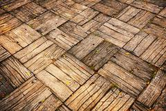 Weathered parquet style decking at oblique angle Stock Photos