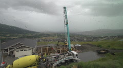 Time-lapse, rain and concrete pump truck Stock Footage