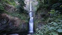 2 tier huge waterfall with a bridge Stock Footage