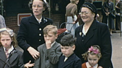 Stock Video Footage of England 1955: family at the fun fair