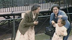England 1955: grandmothers playing with their granddaughter Stock Footage