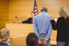 Judge about to bang gavel on sounding block Kuvituskuvat