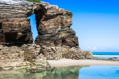 las catedrales beach in galicia, spain. paradise beach in ribadeo, spain - stock photo