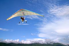flight motorized hang glider - stock photo