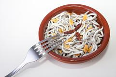 bowl with imitation young eels cooked - stock photo