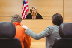 Judge and lawyer discussing the sentence for prisoner - stock photo