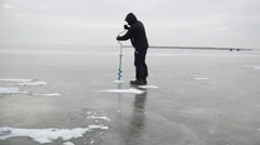 Fisherman on the frozen lake. Stock Footage
