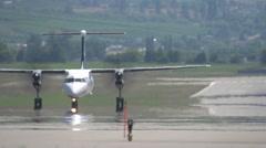 aircraft, Westjet dash8 aircraft taxi - stock footage