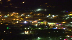 City retail area long lens night surreal, very long shot, aerial Stock Footage