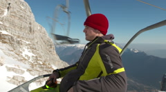 Skier Enjoys Riding On Ski Lift On A Sunny Winter Day Stock Footage