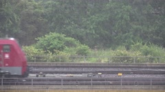 ULTRA HD 4K Goods train pass rainy day rain storm rail transportation railway  Stock Footage