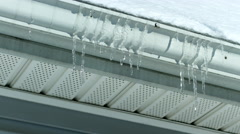Time lapse of icicles melting on gutter 4K - stock footage