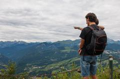 father and his child in the mountain - stock photo