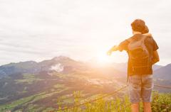 father sand child in the mountain during the sunset - stock photo