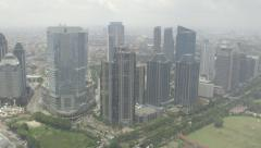 Helicopter skyline view of Jakarta Business District Stock Footage
