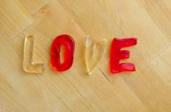 Love in gummy letters Stock Photos