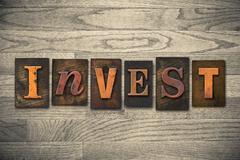 Invest concept wooden letterpress type Stock Photos