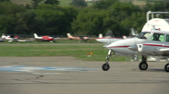 Aircraft, Cessna 320 aircraft taxi to follow me sign at small airport, Stock Footage