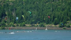 People kite boarding in Columbia river Stock Footage