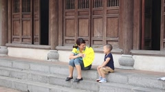 Baby and mother outside a temple Stock Footage