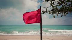 Red Safety Flag on the Beach Stock Footage
