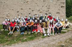 grup of boys and girls wiyh withe mask - stock photo
