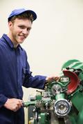 Engineering student using heavy machinery - stock photo