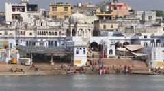 Video 1920x1080 Indian people at ritual washing in sacred lake, Pushkar. India Stock Footage